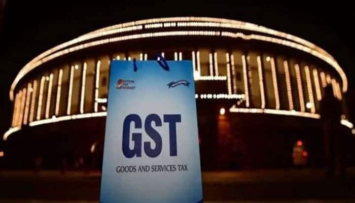 Big companies will be caught if they don't pass on GST benefit to customers: Adhia
