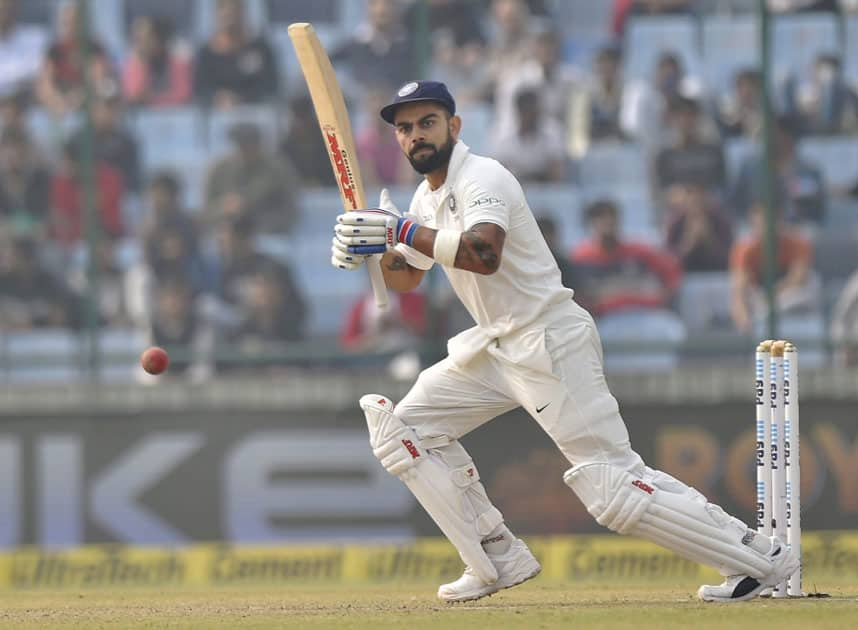 Virat Kohli plays a shot against Sri Lanka during the first day of the third cricket test match at Feroz Shah Kotla, in New Delhi.