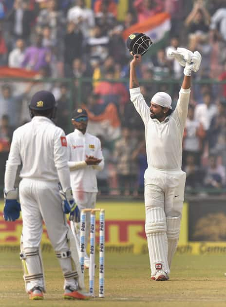 Indian cricketer Murali Vijay celebrates after completing his century against Sri Lanka during the first day of the third cricket test match at Feroz Shah Kotla, in New Delhi.