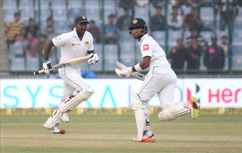Sri Lanka's Angelo Mathews and Dinesh Chandimal in action on Day 2 of the third test match between India and Sri Lanka at Feroz Shah Kotla Stadium in New Delhi.