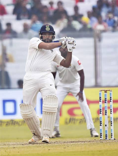 India's Rohit Sharma plays a shot against Sri Lanka during the second day of the third cricket test match at Feroz Shah Kotla, in New Delhi.
