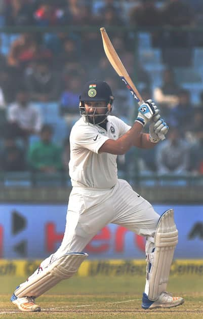 India's Rohit Sharma plays a shot during the second day of the third cricket test match against Sri Lanka at Feroz Shah Kotla, in New Delhi.