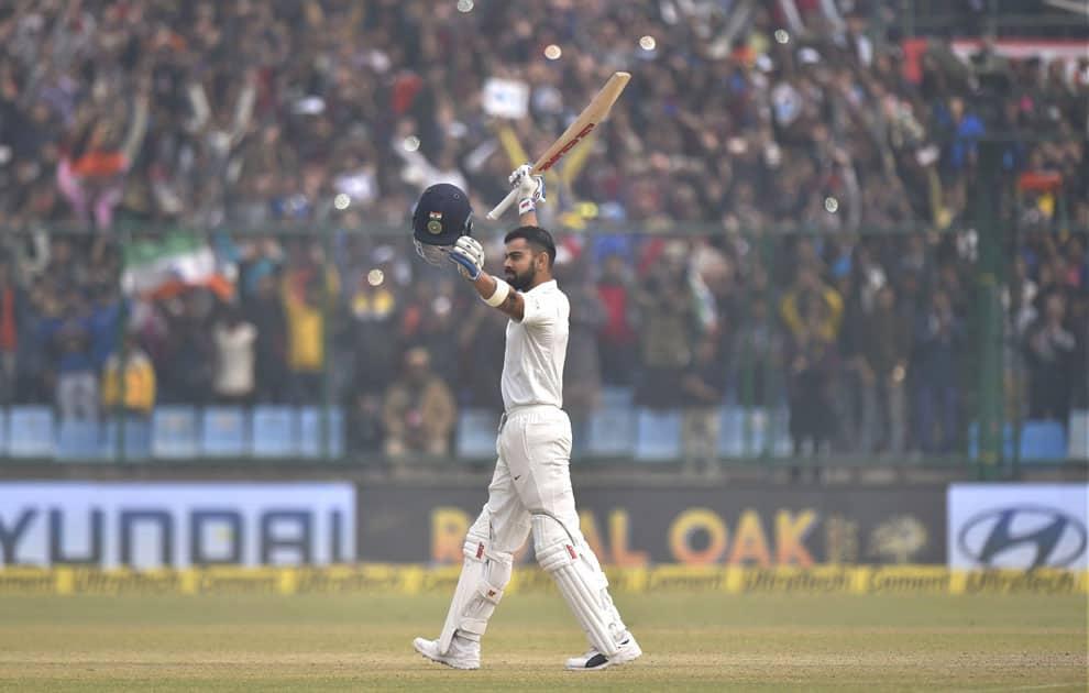 India's Virat Kohli celebrates his double century against Sri Lanka during the second day of the third cricket test match at Feroz Shah Kotla, in New Delhi.