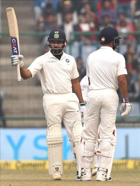 India's Rohit Sharma celebrates his half-century on Day 2 of the third test match between India and Sri Lanka at Feroz Shah Kotla Stadium in New Delhi.