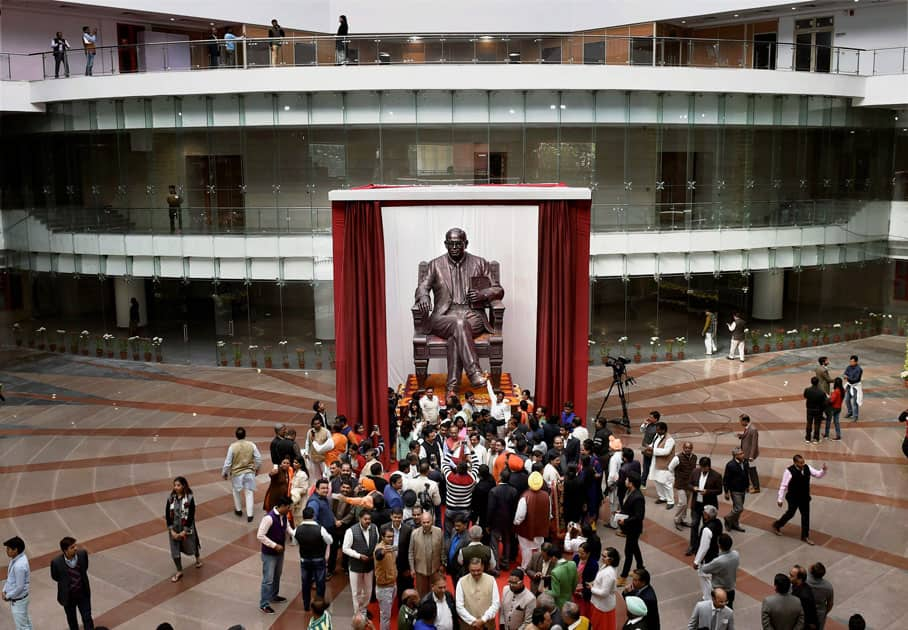 People clicking pictures of a statue of Dr. BR Ambedkar installed at Dr. Ambedkar International Centre, that was dedicated to the nation by the Prime Minister in New Delhi.