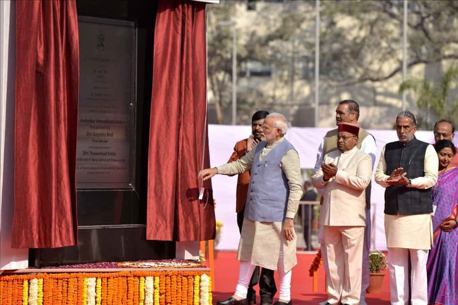 Prime Minister Narendra Modi unveils the plaque to inaugurate Dr. Ambedkar International Centre in New Delhi.