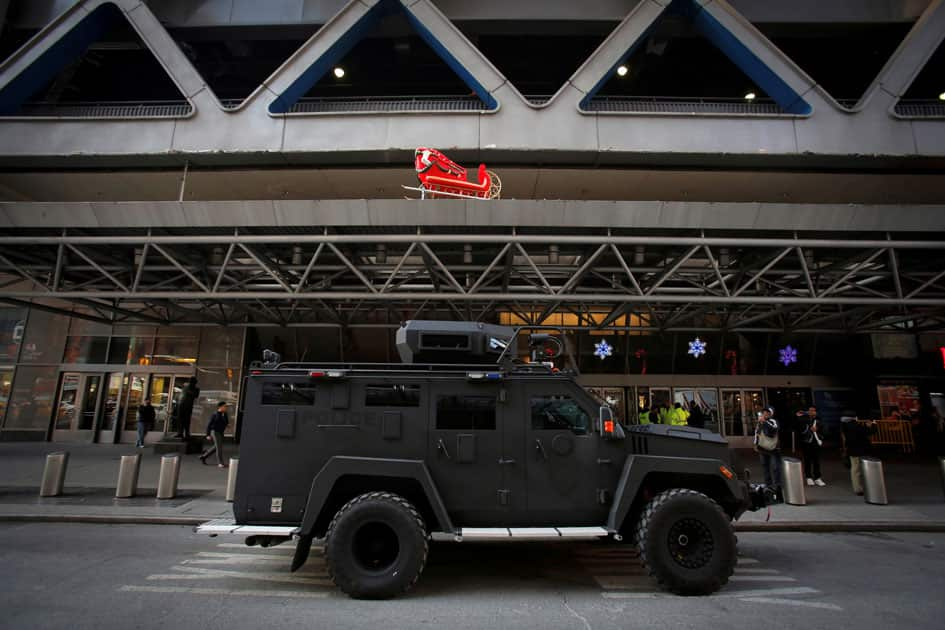 An armored vehicle belonging to the New York Port Authority sits beneath a Christmas decoration at the entrance of the New York Port Authority Bus Terminal following an attempted detonation during the morning rush hour, in New York City.
