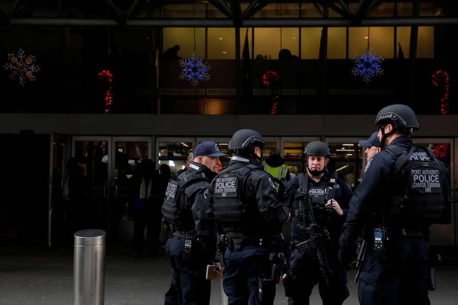 Members of the Port Authority Police Counter Terrorism Unit gather at the entrance of the New York Port Authority Bus Terminal following an attempted detonation during the morning rush hour, in New York City.