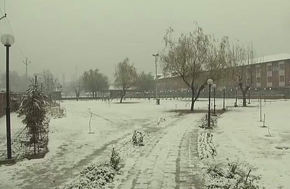 Srinagar receives season's first snowfall, Jammu & Kashmir.
