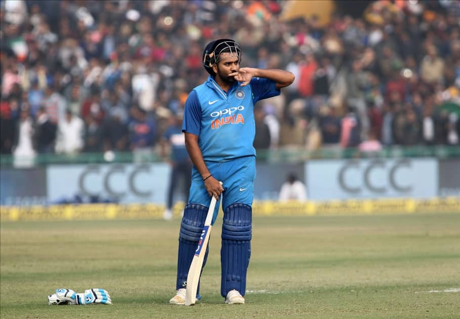 Indian captain Rohit Sharma celebrates his third ODI double century during the second One Day International (ODI) match between India and Sri Lanka at Punjab Cricket Association IS Bindra Stadium in Mohali.