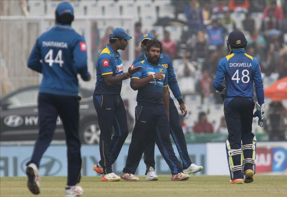 Sri Lanka's Sachith Pathirana celebrates fall of a wicket of India's Shikhar Dhawan during the 2nd One Day International (ODI) match between India and Sri Lanka at Punjab Cricket Association IS Bindra Stadium in Mohali.