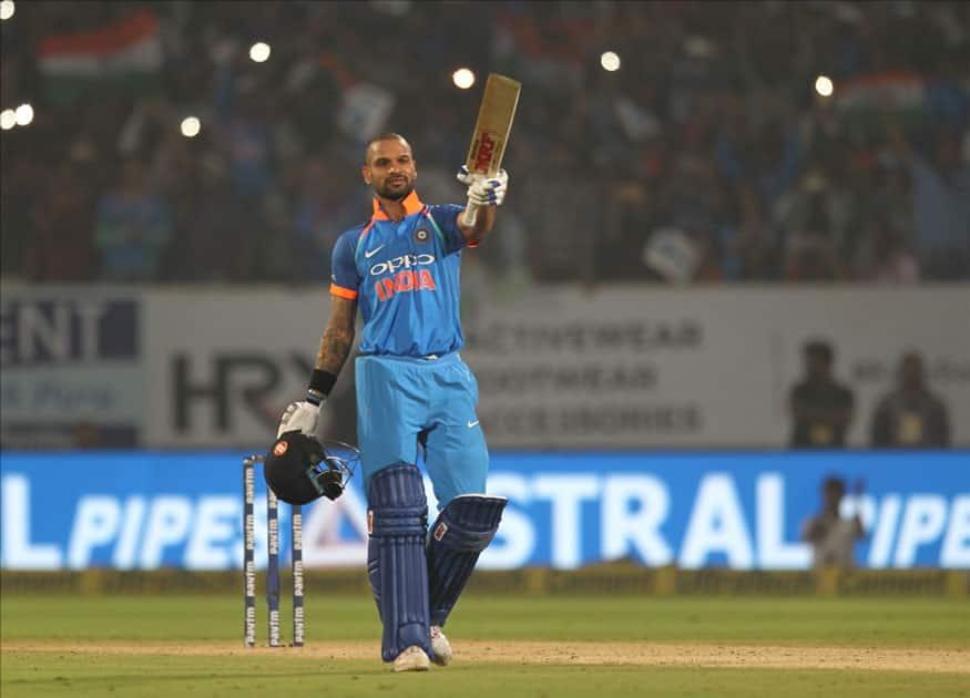 Shikhar Dhawan of India celebrates his century during the third ODI between India and Sri Lanka at Dr. Y.S. Rajasekhara Reddy ACA-VDCA Cricket Stadium in Visakhapatnam.