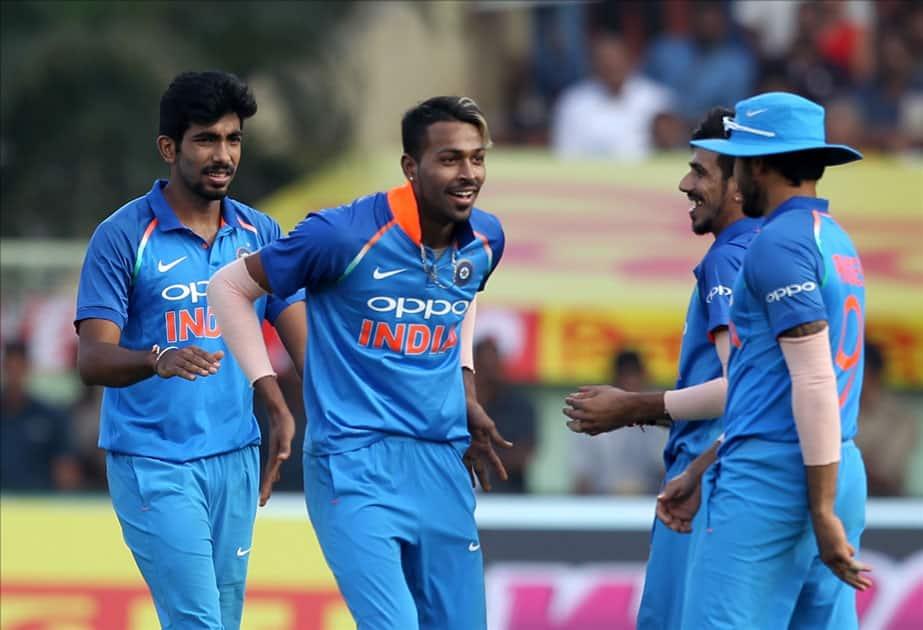 India's Hardik Pandya and Yuzvendra Chahal celebrate fall of a wicket of Sri Lanka''s Sachith Pathirana during the third ODI between India and Sri Lanka at Dr. Y.S. Rajasekhara Reddy ACA-VDCA Cricket Stadium in Visakhapatnam.