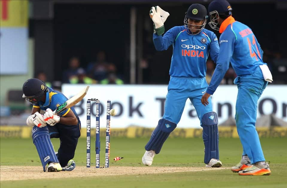 Akila Dananjaya of Sri Lanka gets dismissed during the third ODI between India and Sri Lanka at Dr. Y.S. Rajasekhara Reddy ACA-VDCA Cricket Stadium in Visakhapatnam.