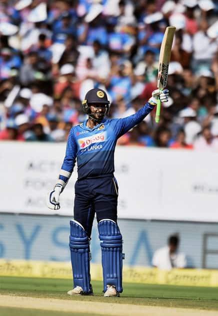 Sri Lankan player Upul Tharanga celebrates his half century during the 3rd and final ODI cricket match against India.
