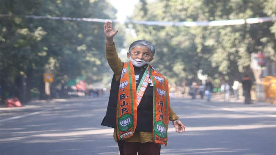 A young boy dressed as PM Narendra Modi is seen at BJP headquarters in New Delhi
