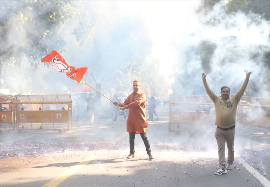 A party worker during celebrations over the party's performance in Himachal Pradesh and Gujarat assembly elections in New Delhi.