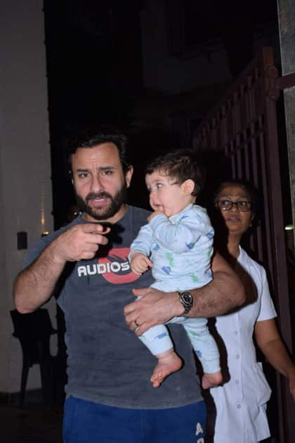 Actor Saif Ali Khan along with his son Taimur Ali Khan at Actress Soha Ali khan's residence on the occasion of her birthday in Mumbai.