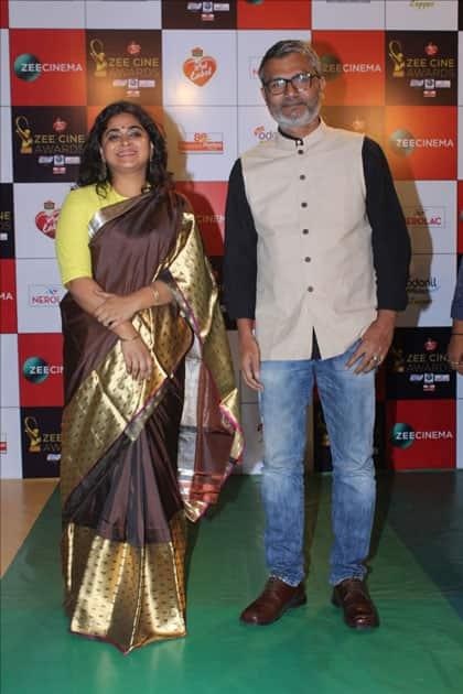 Director Nitesh Tiwari along with his wife Ashwiny Iyer Tiwari at the red carpet of