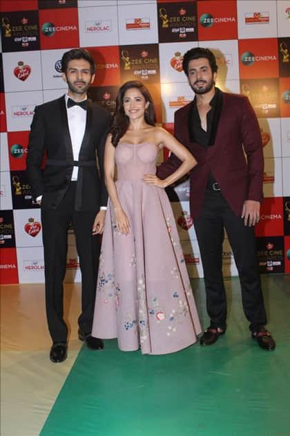 Actors Kartik Aaryan, Nushrat Bharucha and Sunny Singh at the red carpet of