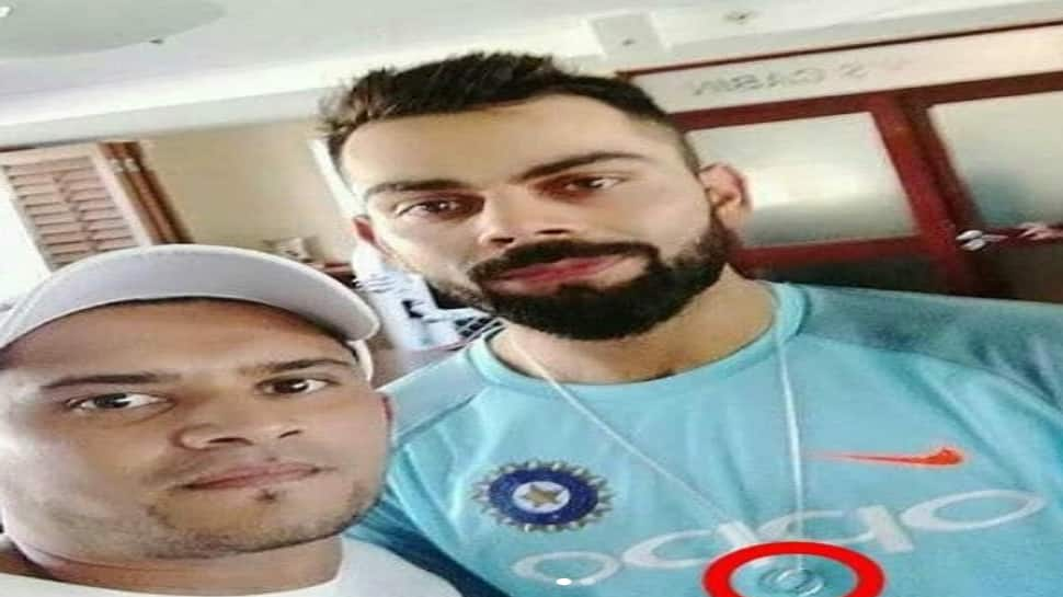 Virat Kohli spotted wearing a wedding ring on his neck?