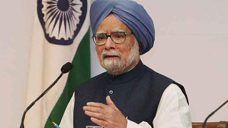 Happy you stand vindicated in 2G case: Manmohan Singh to A Raja