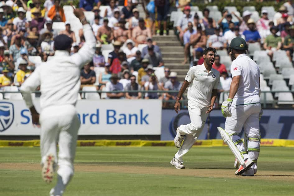 Indian fast bowler Bhuvneshwar Kumar takes the wicket of Dean Elgar of South Africa in the first over on the first day of their first day test between South Africa and India at Newlands Stadium in Cape Town, South Africa.