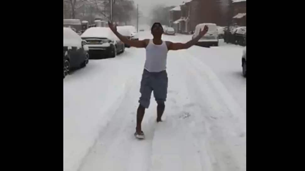 Viral video: Man grooves to 'Aa Jao Meri Tamanna' song in the snow wearing vest and shorts