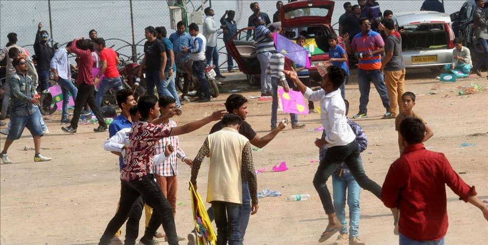 People fly kites on Makar Sankranti in Hyderabad.