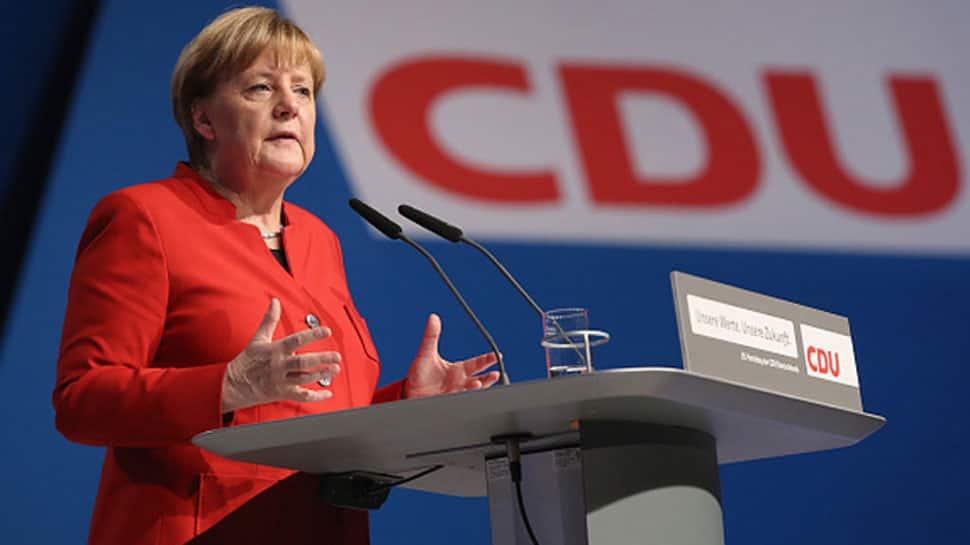Angela Merkel upbeat as coalition talks with Germany's Social Democrat start