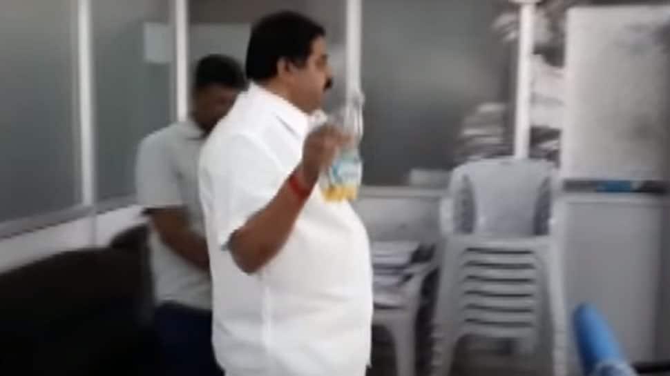 Caught on camera: Karnataka Congress leader sprinkles petrol, threatens to set govt office on fire