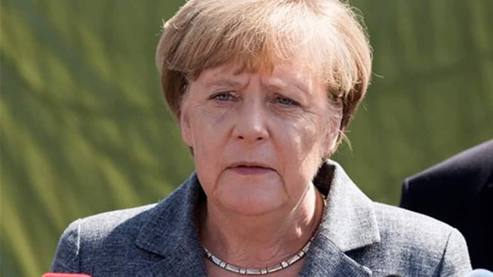 Angela Merkel quells party rebellion ahead of coalition deal vote