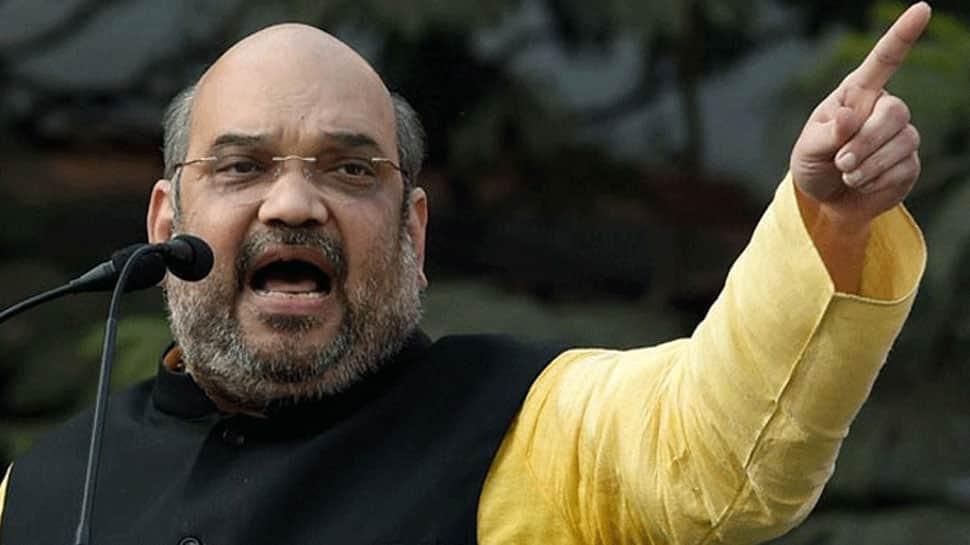 Amit Shah mimics Rahul Gandhi in poll-bound Karnataka