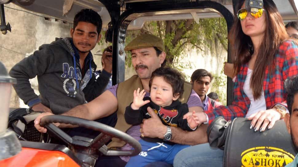 Taimur Ali Khan chilling like a boss on daddy Saif Ali Khan's lap while mommy Kareena looks at him—Pics