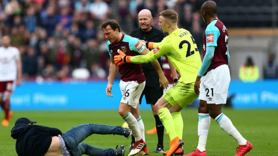 Premier League: West Ham United fans invade pitch, force team owners to flee seats