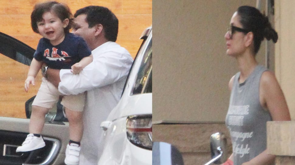 Taimur Ali Khan looks like the happiest baby in town while mommy Kareena looks away in style-Pics