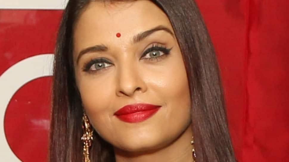 Aishwarya Rai Bachchan flaunts curly hair, shimmers in dull gold shirt on the cover of Femina India magazine