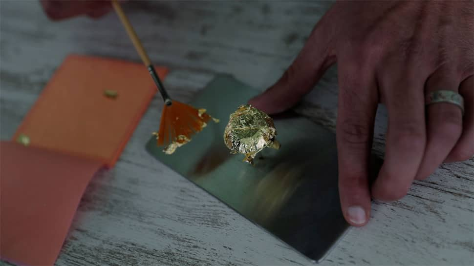 Covered in edible gold, world's priciest chocolate goes on display in Portugal