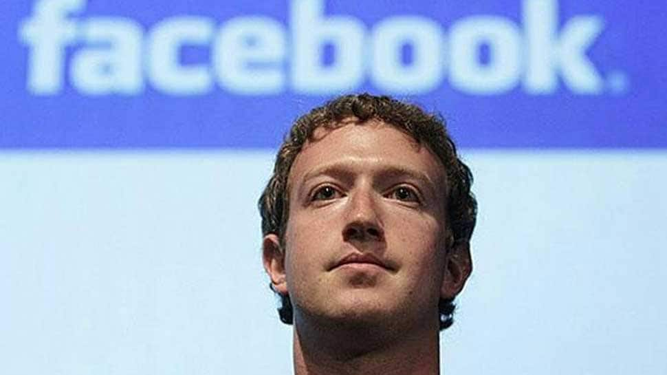 After global outcry over Facebook data theft, Mark Zuckerberg says 'time to step up'