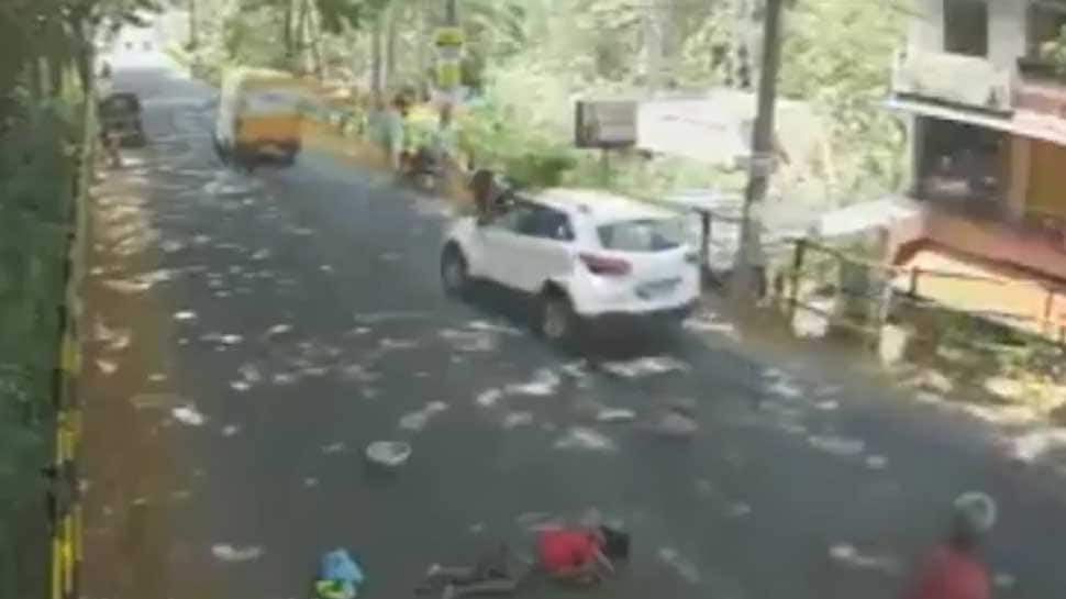 Caught on camera: Kerala woman lying on busy road, none comes to her rescue