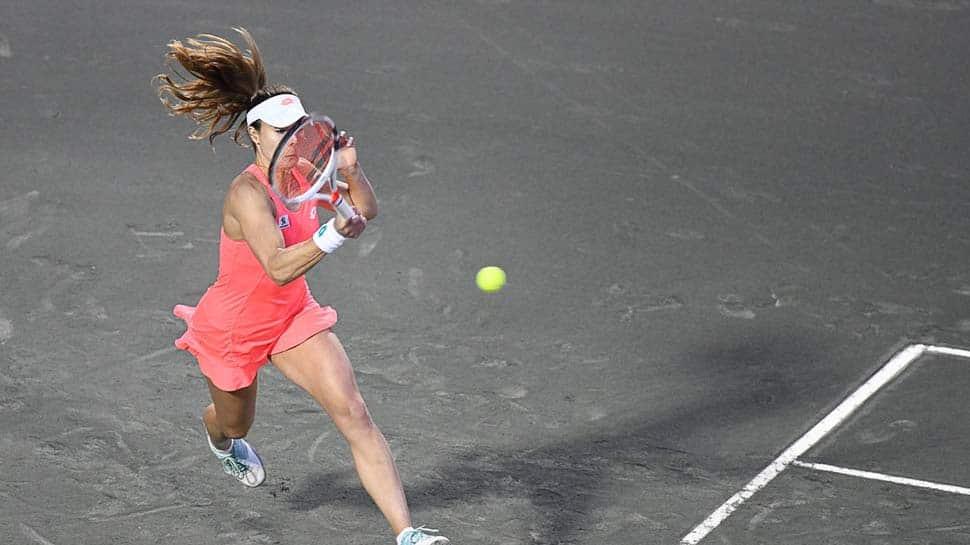Alize Cornet upsets Caroline Garcia to advance in Charleston Open