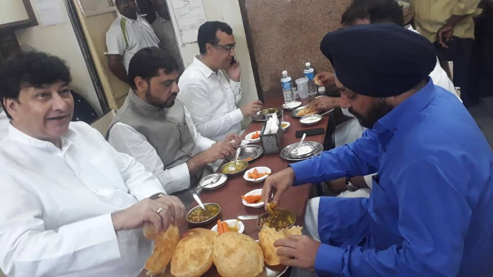 BJP leader claims Congress men had meal at hotel before Rajghat fast, shares pic