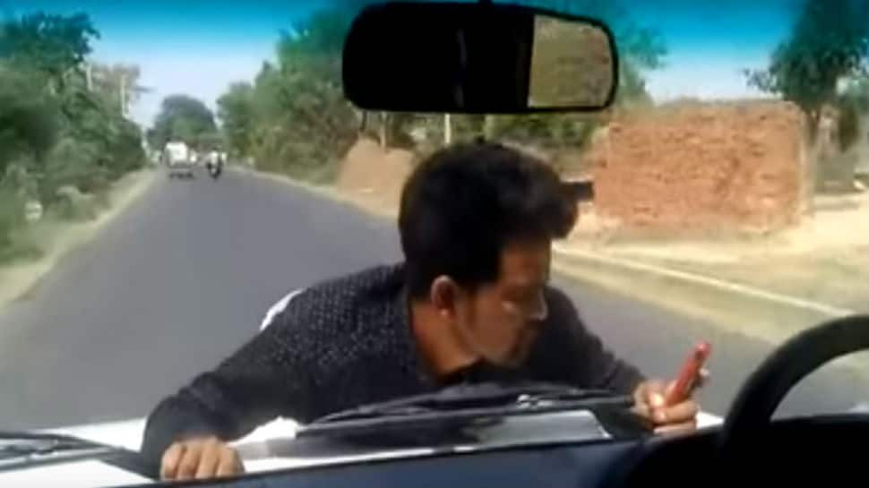Watch: Shocking video shows government official driving with protesting man on bonnet