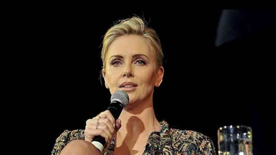 Charlize Theron says she may leave the US because of racism