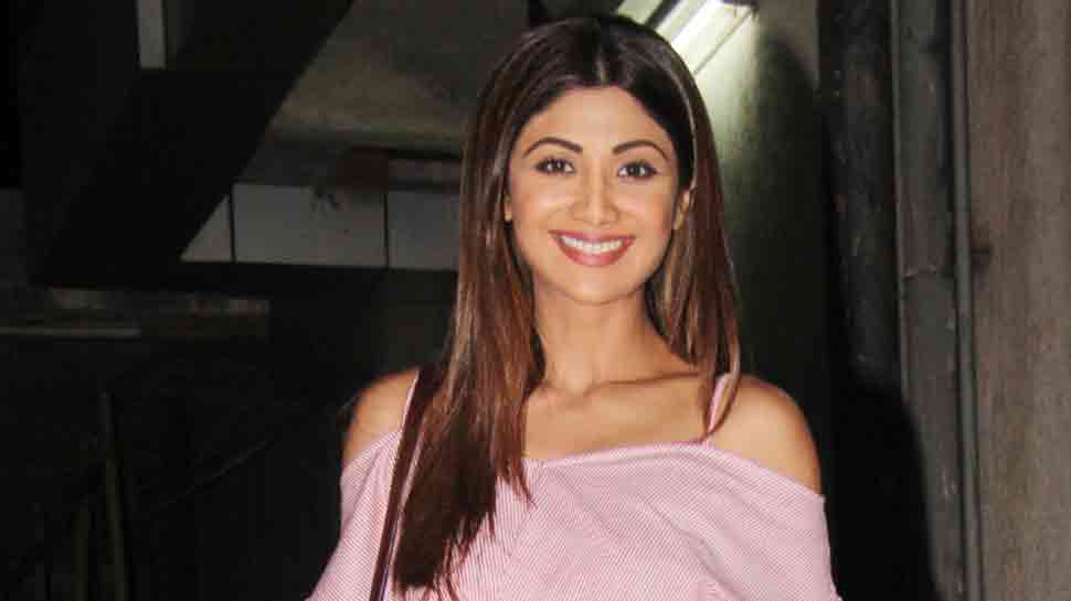 Shilpa Shetty looks stylish in this pink top, flared denim  — See photos