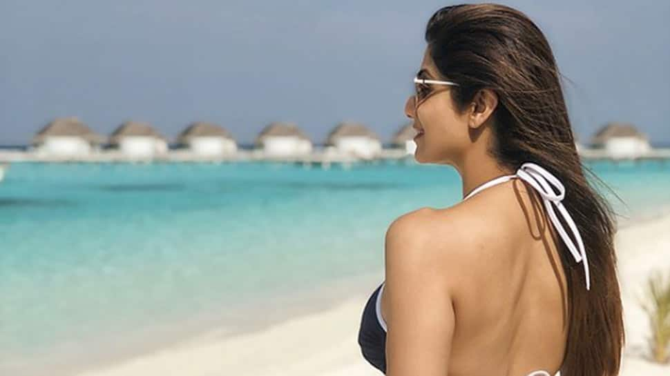 Shilpa Shetty soaks up the sun in bikini, imitates Shah Rukh Khan in this pic