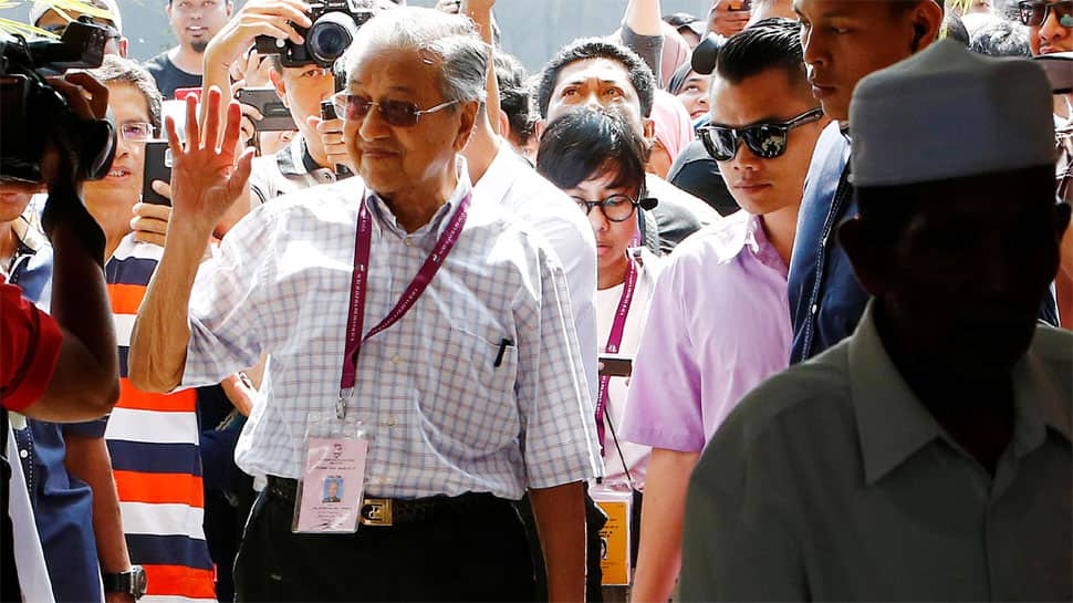 Mahathir Mohamad claims election win over ruling coalition in Malaysia