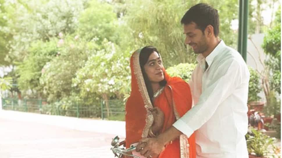 Love in the air: Tej Pratap Yadav takes Aishwarya Rai on a bicycle ride