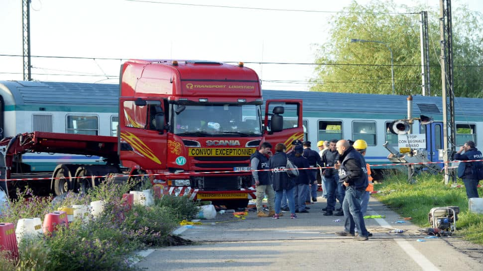Two dead, 18 injured after train crashes into lorry in Italy