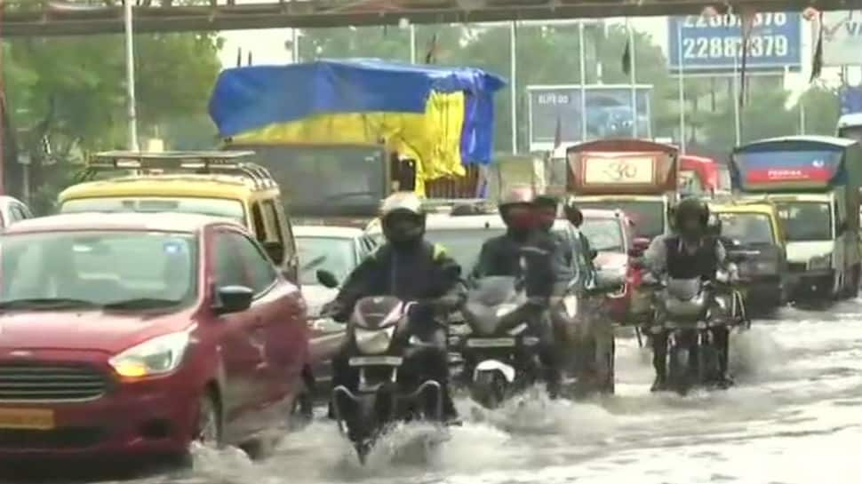 Heavy showers in Mumbai: Commuters struggle on water-logged roads, train services hit